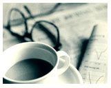 Image of Newspaper, coffee cup and  eyeglasses